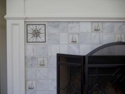 Sailboat and compass accent fireplace install