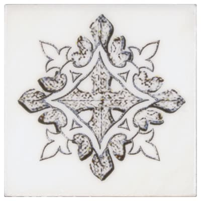 Single Accent tile in Chateau Emblem Pattern on Carrara white marble