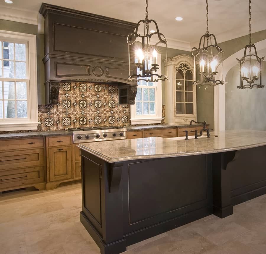 Natural Stone Kitchen Backsplash on Light Travertine tile featuring Amaretti Pattern in Earth