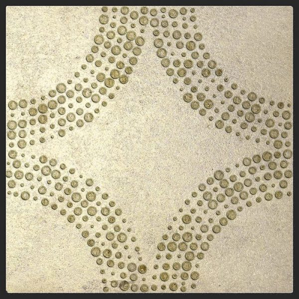 Decorative single tile featured in Cabochan Pattern Jasper on Gold Luster Limestone
