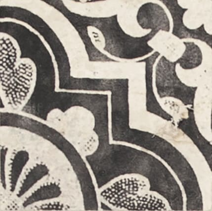 Damico Collection single tile in DD61 pattern featuring dark tones on natural stone
