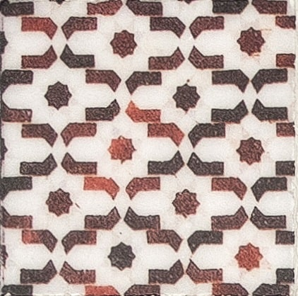 Damico Collection single tile in DD76 Pattern featuring red and black tones on natural stone