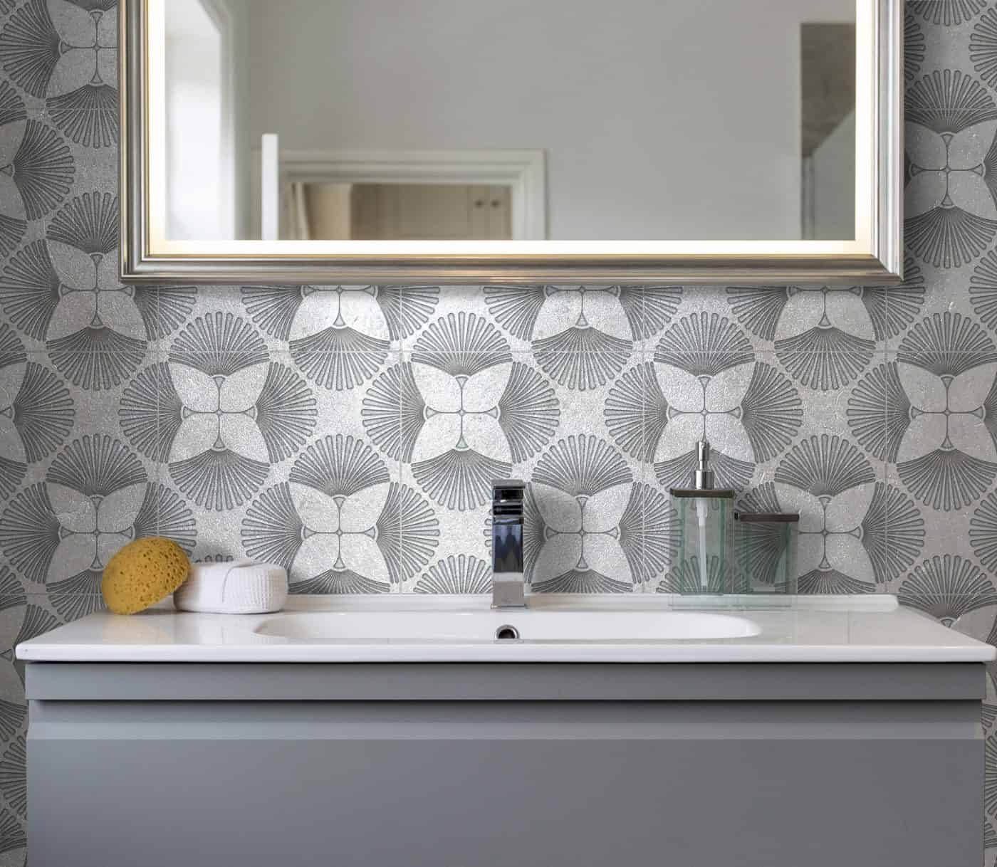 Decorative Bathroom Backsplash on Silver Luster Limestone tile featuring Briolette Pattern in Agate