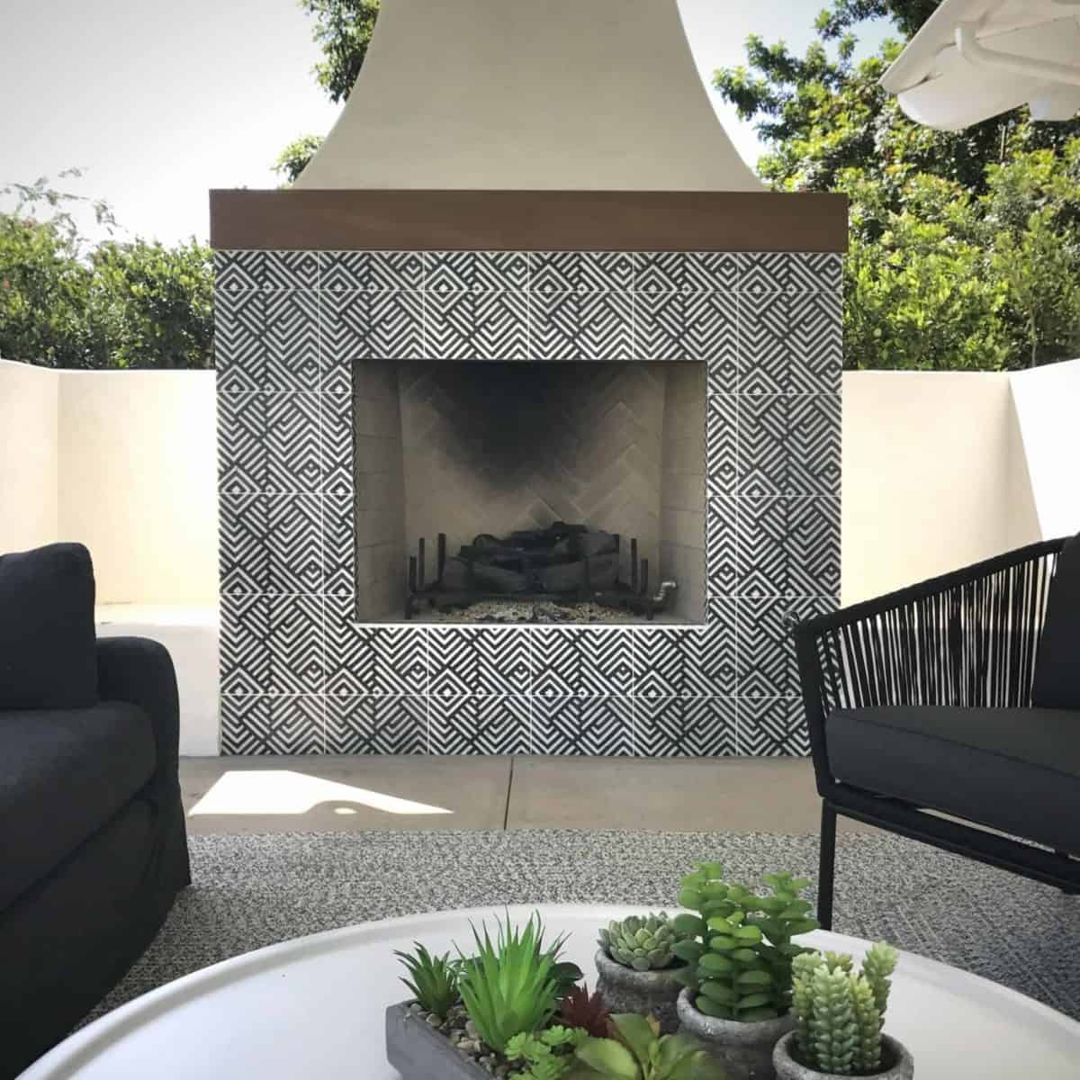 Waterways pattern in black on carrara featured as fireplace