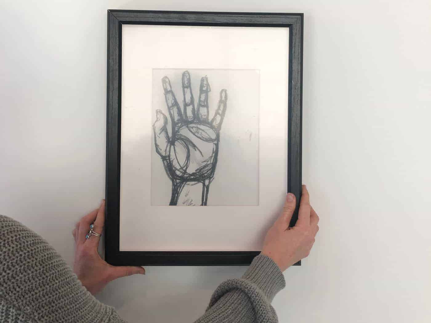 photo of a framed picture of a hand