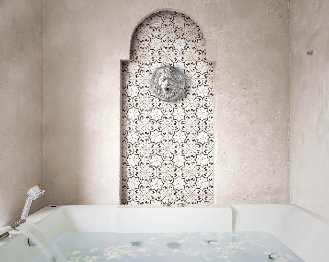 Oasis (black) on Limestone Bathroom feature wall Installation
