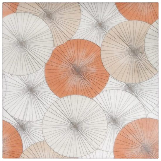 Parasol Tile circular pattern of orange and cream on white marble