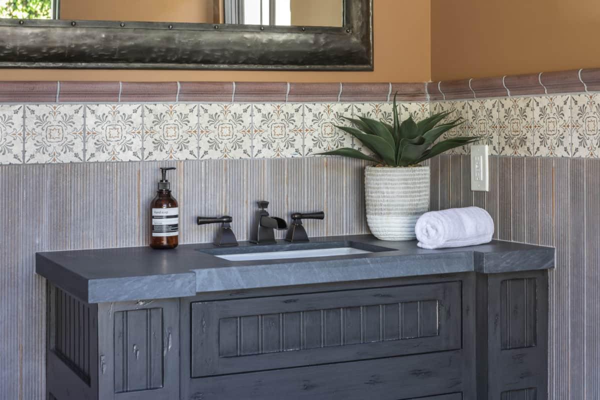 Dana point pattern persimmon on limestone bathroom