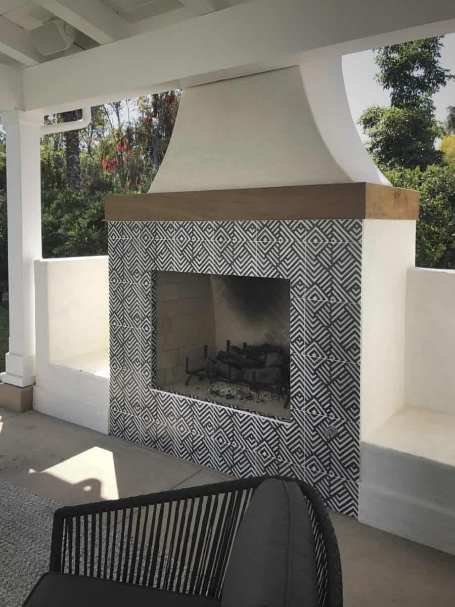 Waterways pattern in black on carrara featured as fireplace tile