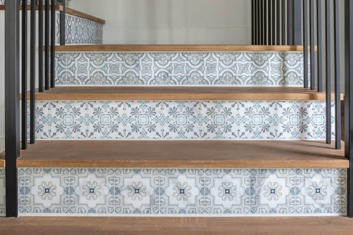 Decorative tile alternating stair risers