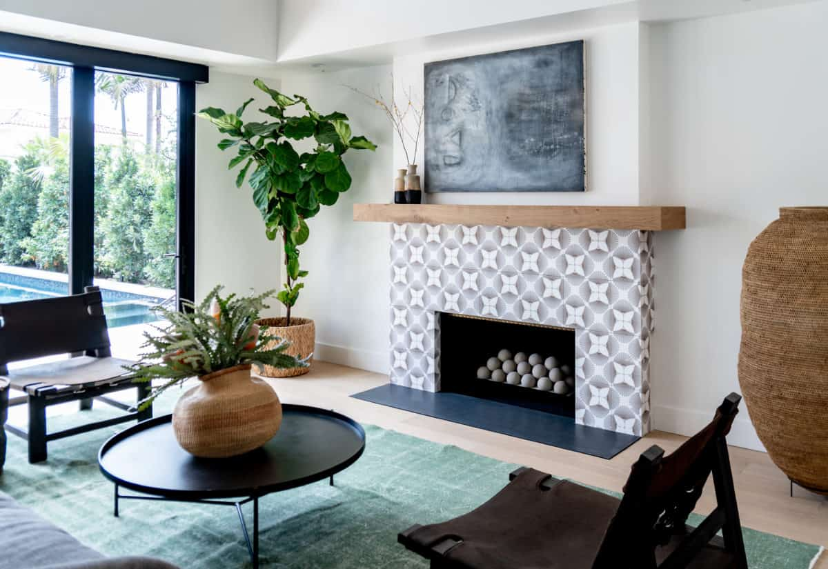 Modern Fireplace featuring Briolette patterned tile on thassos