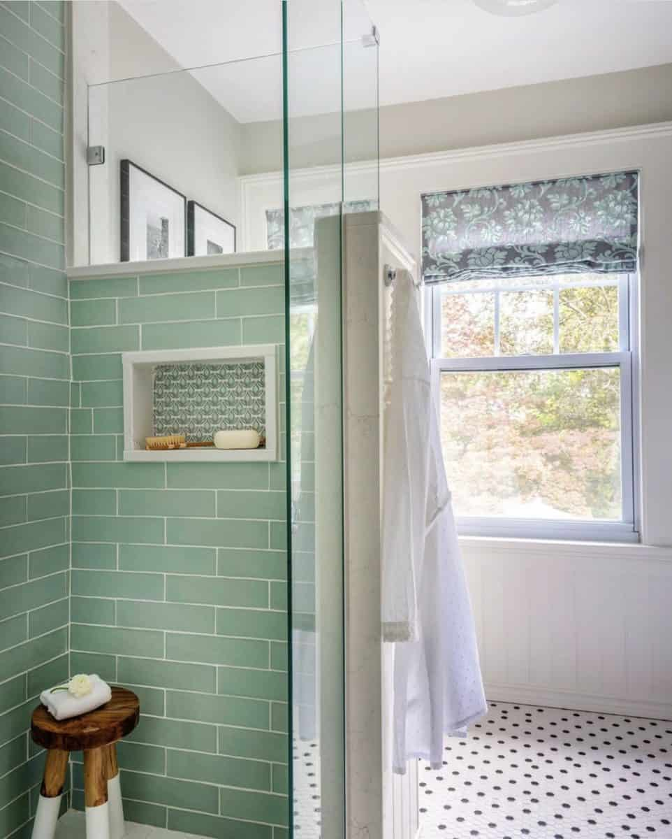 Traditional green bathroom with Iris collection on carrara shower niche