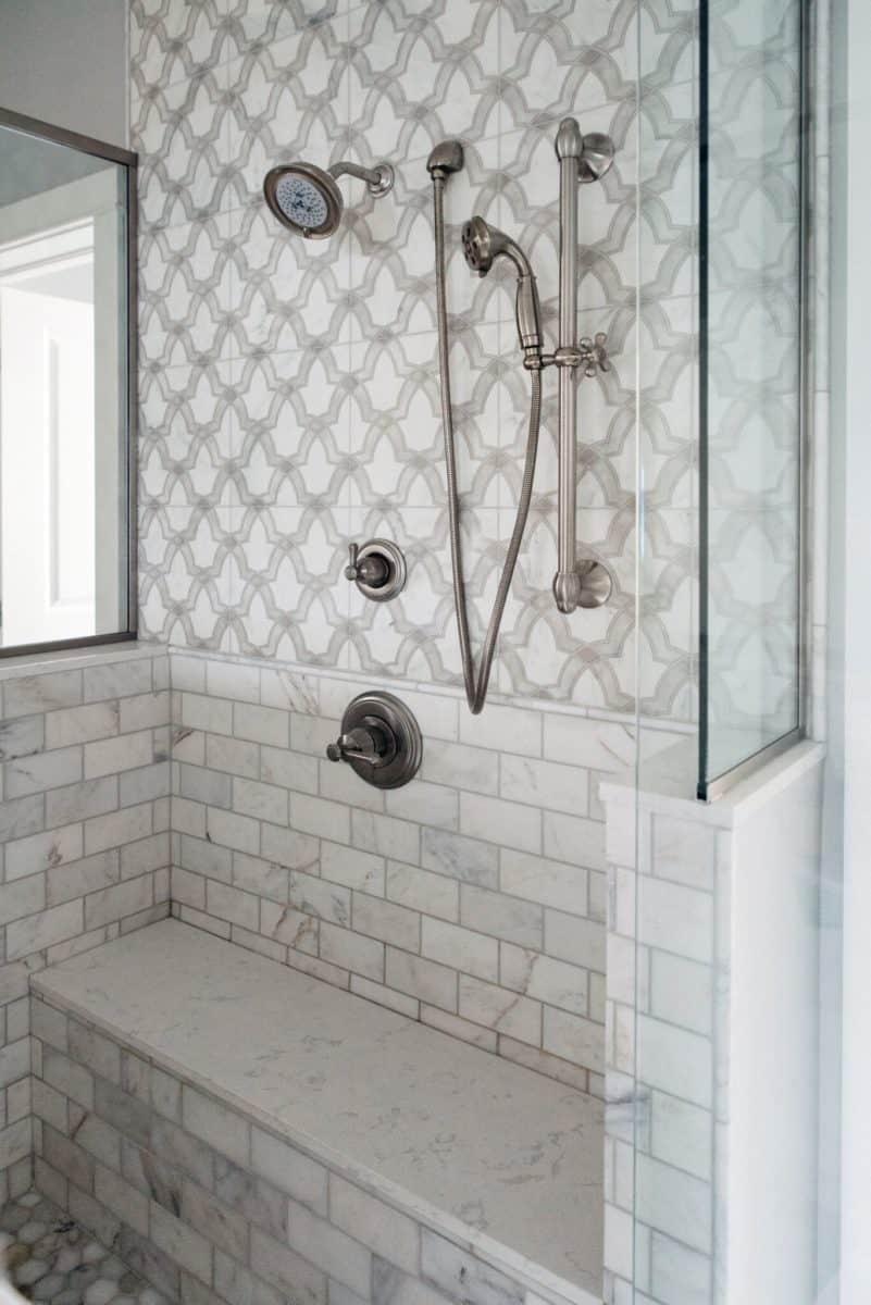 Modern tile featuring evolve pattern on carrara in shower