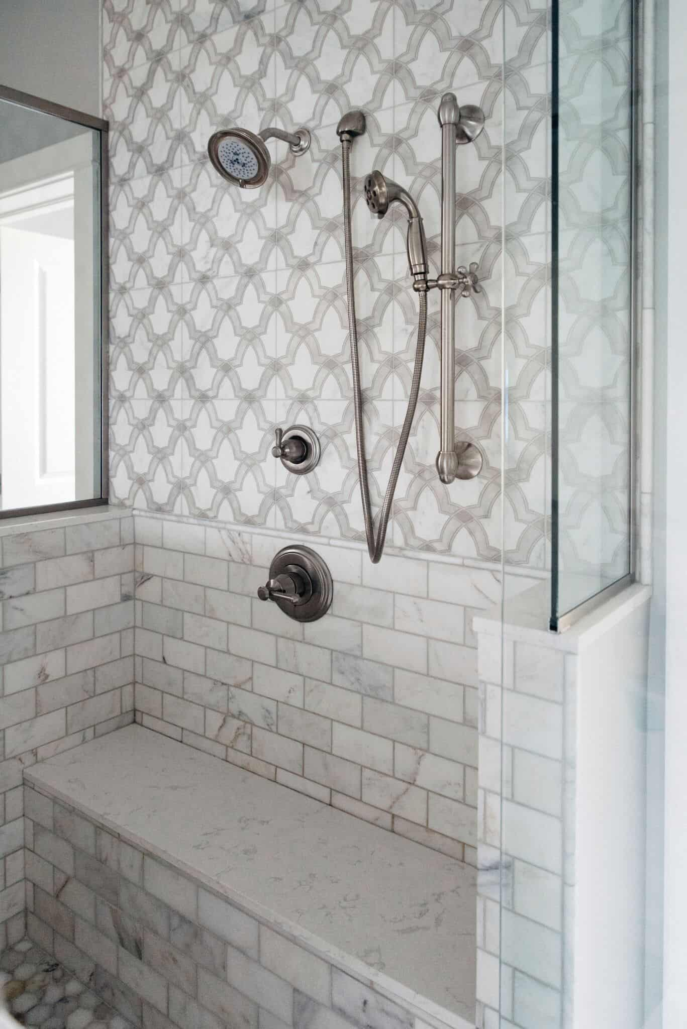 Modern tile featuring evolve pattern on carrara in shower