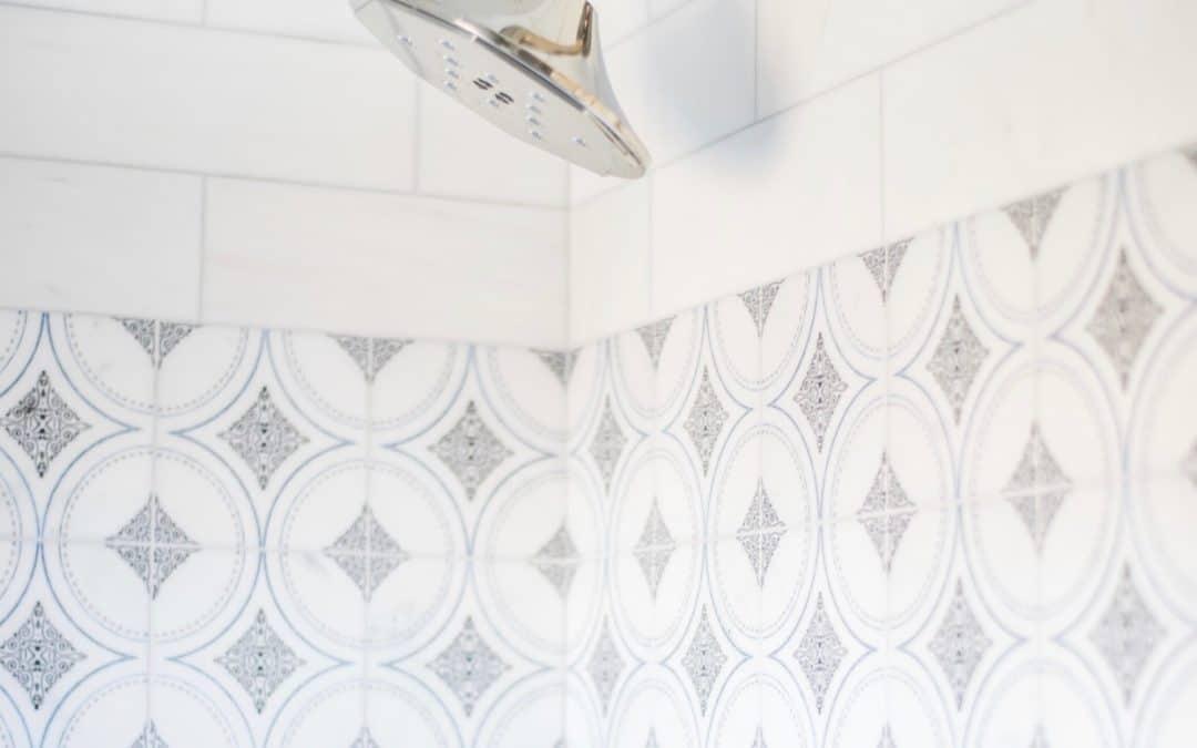 Ventana shower wall tile in deep blue on carrara