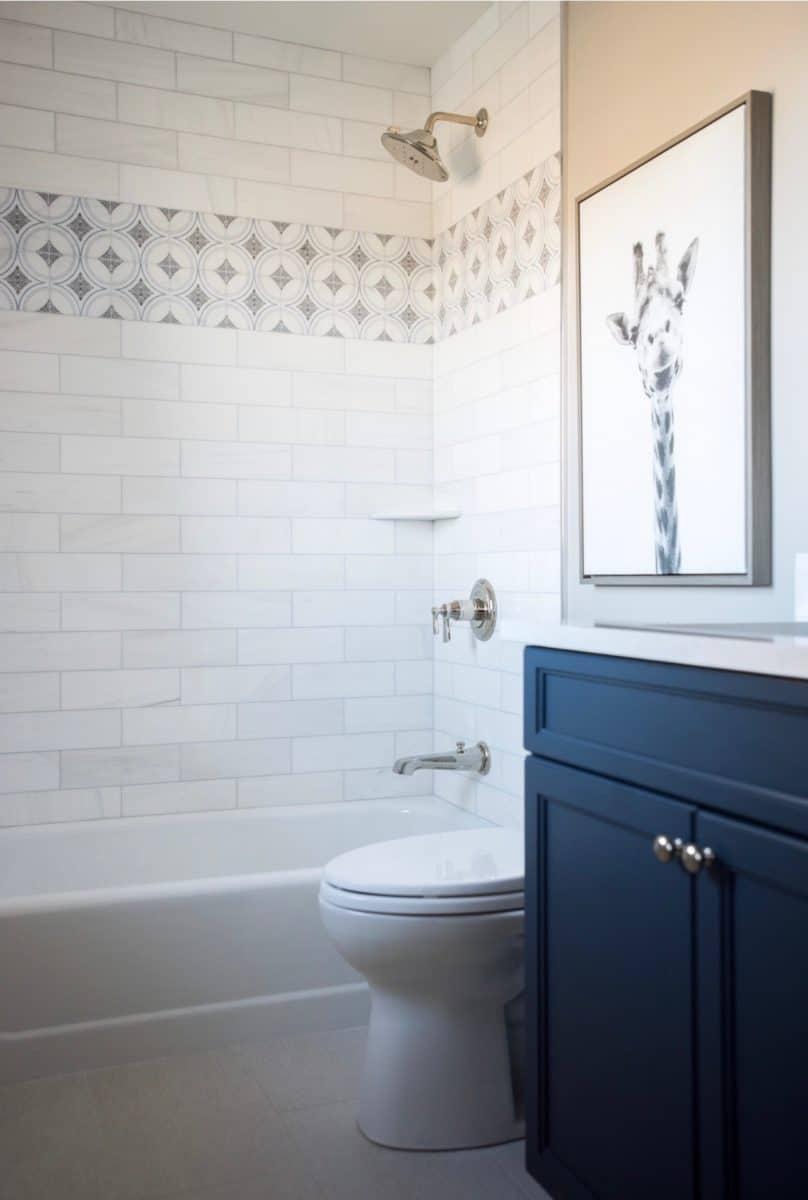 Ventana deep blue tile on carrara in shower wall backsplash