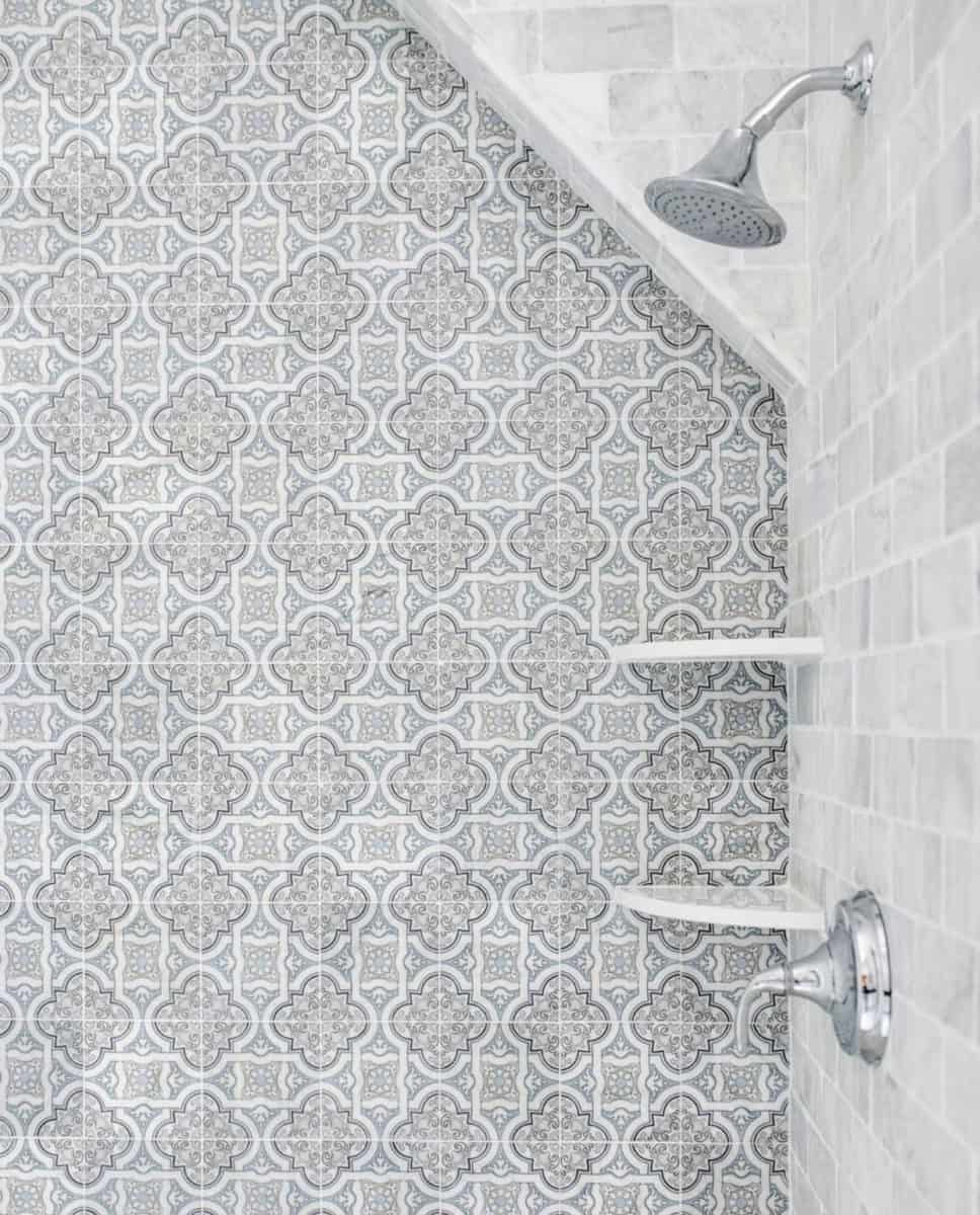 Lena winter blue tile on honed carrara in shower backsplash