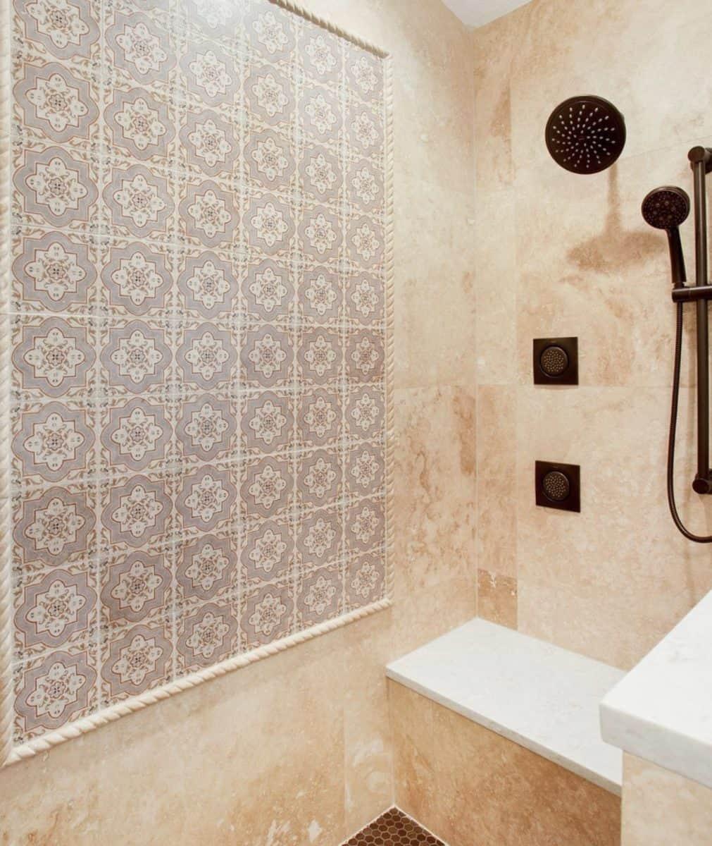 Rustic shower backsplash featuring the catalina pattern on limestone