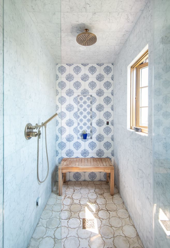 Caprice tile on carrara in sapphire on shower wall